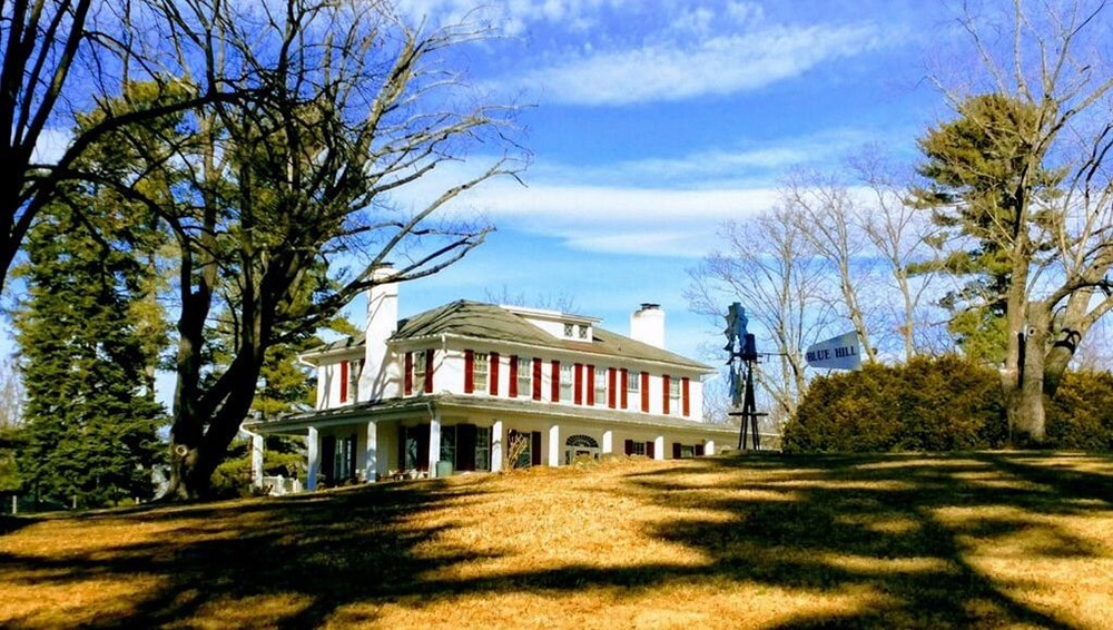 Idyllic photo of a farmhouse on a hill