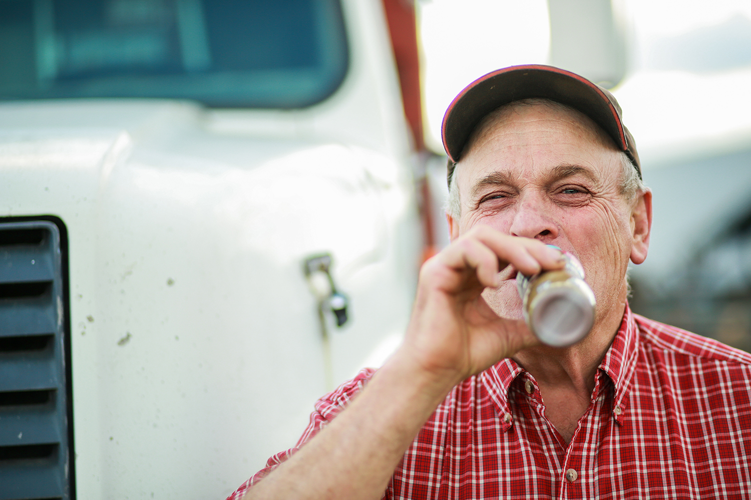 Man drinking chocolate milk in front of a truck