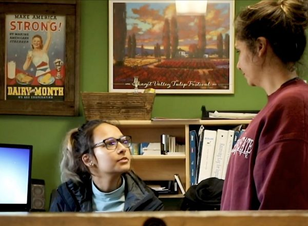 A mother and her daughter in conversation inside a colorful office