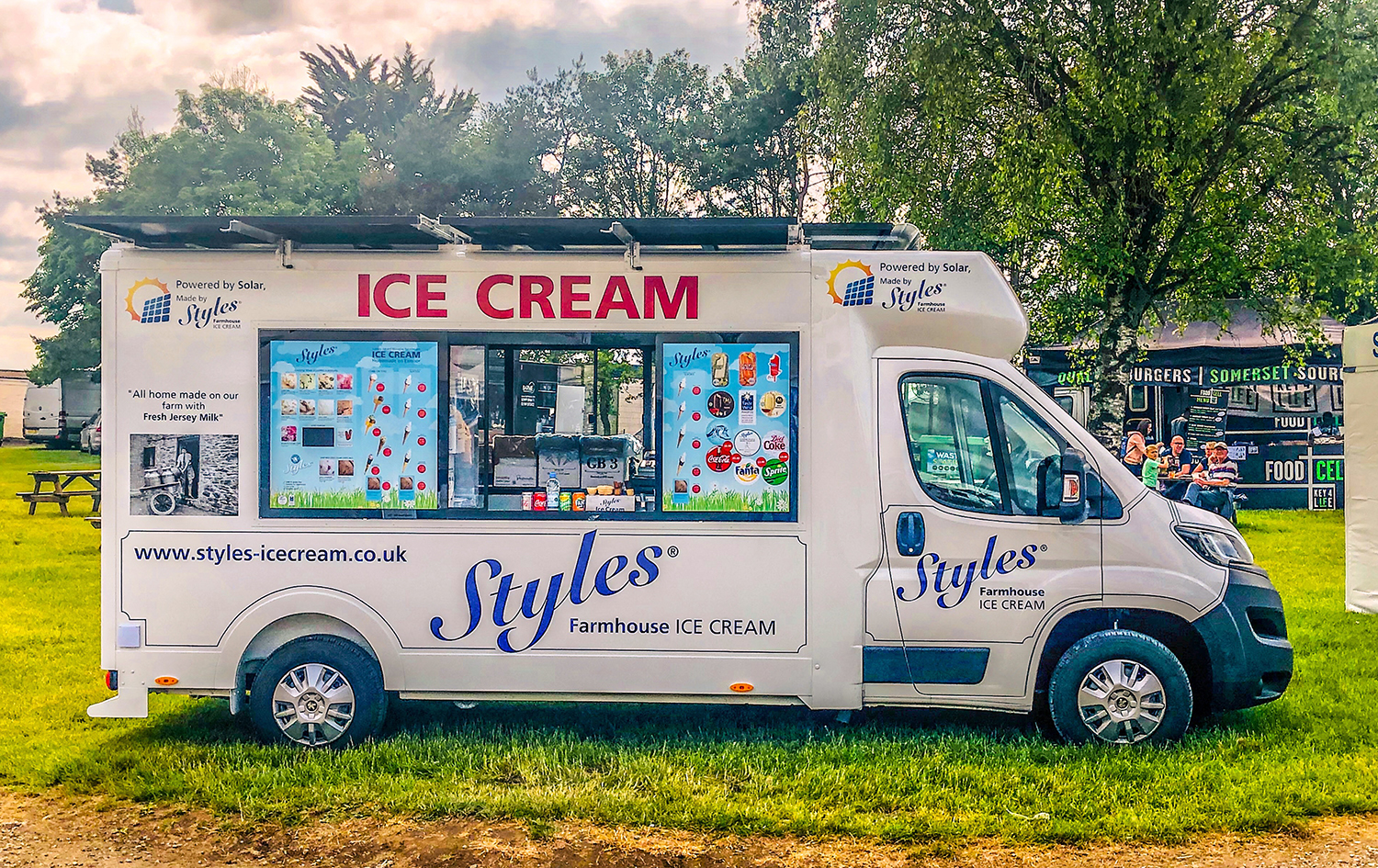 A solar-powered ice cream van on green grass