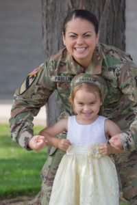 A woman in army uniform with her daughter