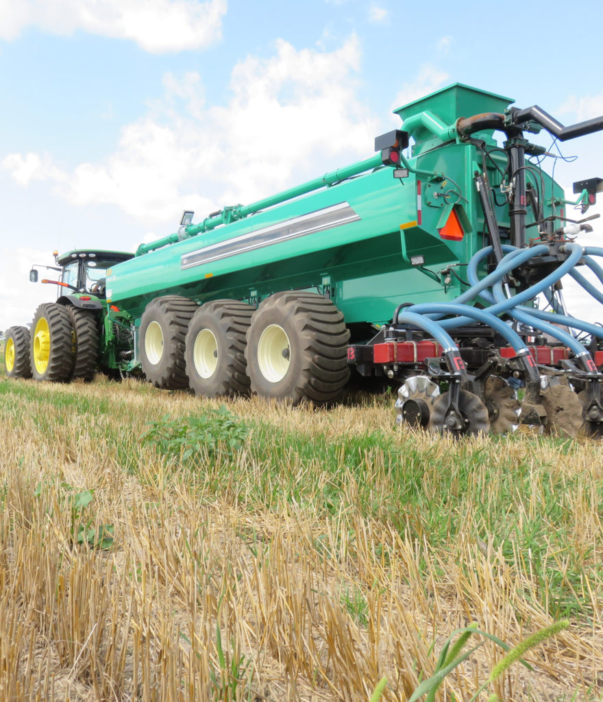 Large agricultural equipment used to spread nutrients on crops