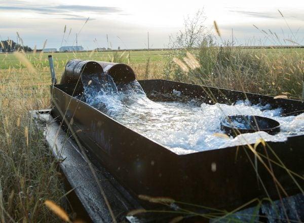 A water trough on farmland
