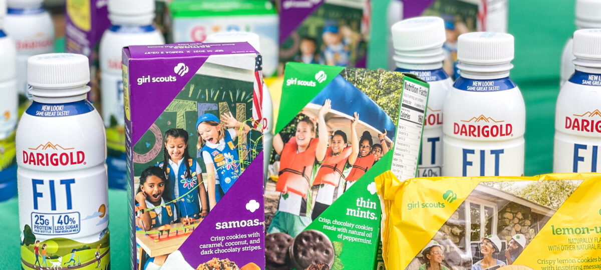 Boxes of Girl Scout cookies and single serve bottles of Darigold FIT milk.